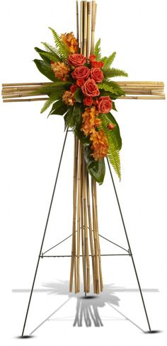 The depth of your faith is sincerely expressed in this simple but elegant cross presented as a standing spray on an easel.