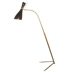Striking Italian 50's Floor Lamp   From a unique collection of antique and modern floor lamps  at http://www.1stdibs.com/furniture/lighting/floor-lamps/