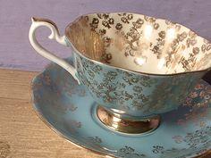 vintage blue tea cup and saucer set, Royal Albert bone china tea cup, Empress series, blue and gold roses English tea set. $79.00, via Etsy.