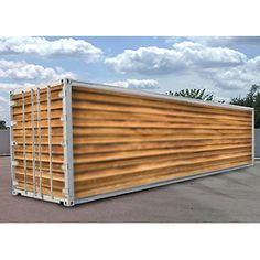 Cropbox - grow 1 acre of crops in a single shipping container while using 90% less water. This one has custom exterior.
