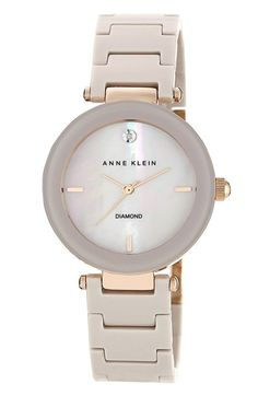 Anne Klein Round Ceramic Bracelet Watch, 33mm at Nordstrom.com. A single diamond inlay at 12 o'clock adds sparkle to a sleek fashion watch set on a stylish ceramic link bracelet.