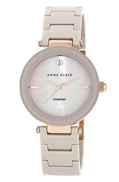 Anne Klein Round Ceramic Bracelet Watch, 33mm at Nordstrom.com. A single diamond inlay at 12 o'clock adds sparkle to a sleek fashion watch set on a stylish ceramic link bracelet.