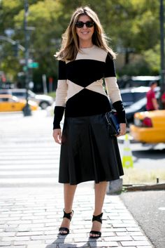 Hot Shots: The Best Street Style at NYFW (Updated!): Carine Roitfeld worked her signature edgy-cum-posh mix.  : Check out the statement jewels on this all-black look.  : Chiara Ferragni was a bit boho inspired in a wide-brim hat and booties to counter her fit-and-flare dress and Céline bag. : Miroslava Duma went for high-wattage sequins and a killer cropped top. : A simple sweater to top a not-so-simple skirt.  : Miroslava Duma was a vision in neutrals.  : Polished in leopard print and…