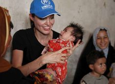 UNHCR Goodwill Ambassador Angelina Jolie holds a newborn baby while visiting a displaced Iraqi family in the Baghdad suburb of Chikook. The baby has a rash most likely brought on by the poor conditions in the settlement. © UNHCR/B.Heger