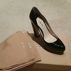 Miu Miu Patent Leather Pumps All black patent leather pumps with a curved heel. This shoe was worn 2 times the piece on the bottom of the shoe was to protect was slipping. The box and the dust bags are available upon purchase.   Price if Firm & Fair No Trades Miu Miu Shoes Heels
