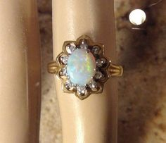 Vintage 14K Yellow Gold Opal and Diamond Halo by OldTimeSparkle
