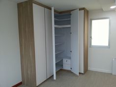 I like the finish of the wardrobe and the L shape! The aircon ledge doesn't look too bad either Corner Closet, Corner Wardrobe, Bed In Closet, Wardrobe Storage, Wardrobe Closet, Closet Bedroom, Coat Cupboard, Hallway Closet, Bedroom Cupboards