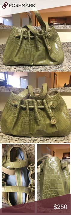 "Vintage Embossed Brahmin Vintage Embossed Brahmin in an Olive color with Brass Hardware! This vintage beauty has a middle zip divider, 1 zip, multiple slip pockets, multiple pen slots and lined in a soft light flannel! The drawstring look is an amazing accent on this bag! Double shoulder strap drop is approx 9"" and measures approx 15"" at base 11.5"" at the top X 10"" (H) X 4"" (D) ❌no trades price firm❌ Brahmin Bags Shoulder Bags"