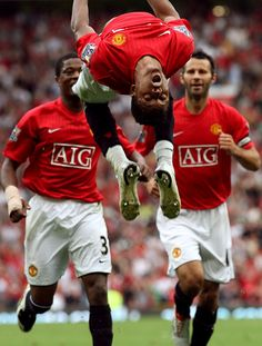 Manchester United's Nani celebrates in acrobatic style after scoring against Tottenham at Old Trafford in August 2007.