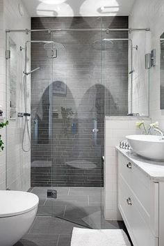 Great small bathroom.  Like the whites and gray colors, and glass door shower. Basin style sink allows for a full drawer under - good storage.