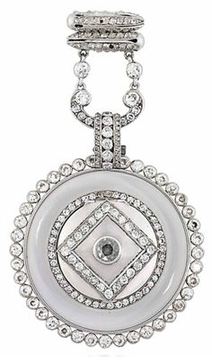 AN EARLY 20TH CENTURY DIAMOND LAPEL WATCH, BY CARTIER. The circular silvered dial with engine turned decoration, black painted Roman numerals and blued steel hands, to the plain polished bezel and rock crystal case with outer diamond border, to a similarly-set surmount with rose-cut diamond points, the reverse with diamond-set hinged locket centre, circa 1920, French marks for gold, 6.8cm long Dial signed Cartier, Paris, case, bezel and dial frame no. 4146, 8210, and 36