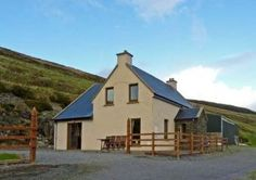 This detached cottage is set in an isolated and elevated position, five miles from Ballinskelligs in County Kerry sleeping six people in three bedrooms. Cottages By The Sea, Country Cottages, Home And Away, Ideal Home, Countryside, Ireland, Cabin, Vacation, House Styles