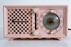 Mid-century Modern Pink Emerson Radio and Clock.