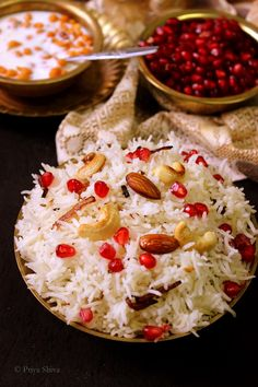 Kashmiri Pulao - an aromatic rice dish cooked with saffron and mild spices. The dish is finally garnished with fresh fruits and nuts.