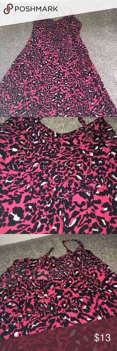 Pink Cheetah Print Dress This is the funniest summer dress!! It ties in the front and has some detailing so it is super flattering. Only worn one time. Torrid Size 1. torrid Dresses