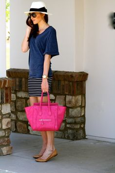 Panama hat and bright pink Celine handbag. I am just loving this combo. Especially with the navy blue shirt.