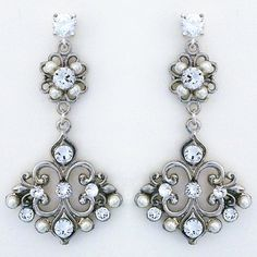 Cheryl King Couture Wedding Jewelry. Vintage bridal chandelier earrings, open filigree design, perfectly placed ivory pearls & crystals.