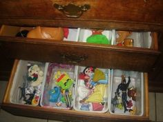 Wipe containers as drawer dividers? Brilliant! Squidmom uses it to store toys, but it is a great idea for storing socks, underwear, hair ties, and scarves.