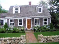 Cute little Cape Cod - love the white borders framing windows and edges!