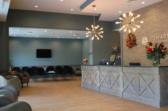 Spa reception idea, back wall and lighting make it all. I love the reception desk, too. reception desk in black Medical Office Decor, Dental Office Design, Office Designs, Optometry Office, Vet Office, Church Office, Office Entrance, Office Lobby, Chiropractic Office Design