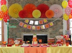 A fun, bright and colorful Elmo themed birthday party idea. I love the color scheme with the splashes of Elmo. I also love how they personalized the Sesame street sign!