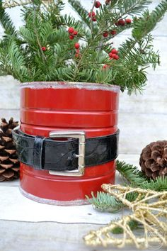 Santa Coffee Can Craft An old coffee can and belt used to make a Santa can to hold greenery, poinsettia plants, or flowers.An old coffee can and belt used to make a Santa can to hold greenery, poinsettia plants, or flowers. Coffee Can Crafts, Tin Can Crafts, Christmas Projects, Decor Crafts, Holiday Crafts, Fun Crafts, Crafts For Kids, Craft Decorations, Santa Crafts
