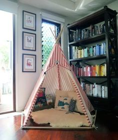 Eva's Play-filled Corners  (If we got a cute enough tent, it could live in the bookshelf corner like this, I think)
