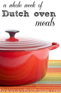 New and shinny red dutch oven with lid on. ** Note: Shallow depth of field