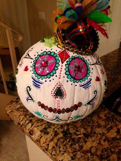 Dia de los Muertos pumpkin painted for work contest