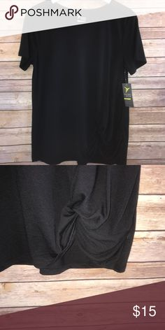 """Old Navy Active Go-Dry Loose Top Size M NWT Old Navy Active Go-Dry loose top in black.  Size M.  Knot detail in front.  65% polyester and 35% rayon.  Machine wash and tumble dry low.  Measures approximately 19"""" armpit to armpit and 26"""" length.  MSRP $19.99.  NWT Old Navy Tops"""