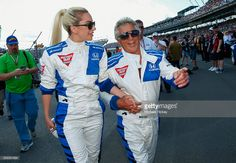 Lady Gaga and Mario Andretti walk to the track before start of the Indy 500 at the Indianapolis Motor Speedway on May 29, 2016 in Indianapolis, Indiana.