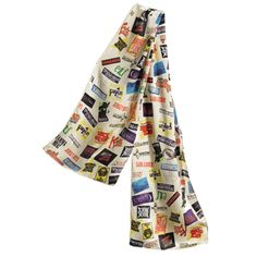 "Remember when people used to dress up to go to the theatre? Well now you can set an example for others by donning this elegant new 10"" x 54"" crème-colored silk scarf featuring your favorite Broadway musical logos. $60"