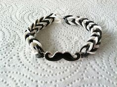 No tutorial, but a neat idea in making rainbow loom bracelets.