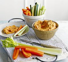 Pack in the vegetables with this quick-to-make dip blitzed with sweet roasted red peppers and served with courgette, celery and carrot batons