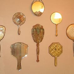 Antique hand mirrors great for wall art!
