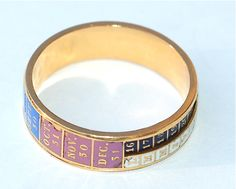 Georgian Perpetual Calendar Ring circa 1820, a French high carat gold and enamel ring in the form of a calendar with moving parts
