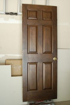 kennedy door-staining white doors to look like wood.
