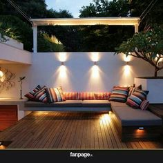 Modern Patio Lighting Wood decking white rendered walls and raised contemporary planter externo workwithnaturefo