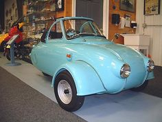 1957 Jurisch Motoplan. Carl Jurisch was an engineer, who built his own motor from scratch at age 24. He designed and built his little car using as a base the body of a Steib S250 sidecar, turned back to front, split down the middle and widened. At least two more cars were built. The second, also blue, was given a taller more practical cabin and ten-inch wheels. The third car, painted red, featured a large box with lid in place of the shapely tail. The whereabouts of these two cars is…