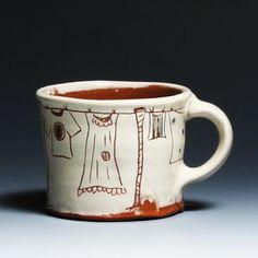 Ron Philbeck Clothes Line Mug. White slip, sgraffito on terracotta