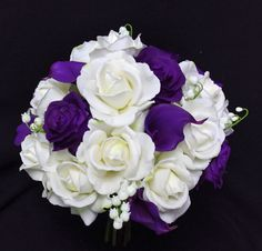 Purple Calla Lilies and Off white roses Wedding Flower Bouquet. An Arrangement made with Natural Touch or Silk flowers.