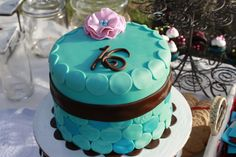 Valerie's sweet 16th birthday cake. Teal and brown round tiles - embossed and painted with luster dust.  Ruffle flower with blue pearl center.