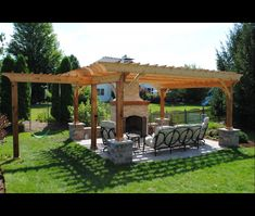 Pergola with swings-- but I would want a swinging bench instead