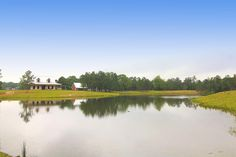 There are two stocked bass fishing ponds totalling approximately 6 acres in size, each with aerators and good drainage. The larger pond, shown here, has a lighted fountain that adds to the outdoor ambiance of this property.