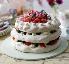 The perfect combination of crunchy yet gooey meringue, billowing cream and an endless variety of toppings. Try Mary Berry's lemon and chocolate pavlova or Nigella Lawson's cappucino version - feast on our very best pavlova recipes. Strawberry Pavlova, Strawberry Recipes, Fruit Recipes, Cake Recipes, Dessert Recipes, Strawberry Blueberry, Party Recipes, Great British Bake Off, Bolo Pavlova