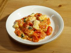 Get this all-star, easy-to-follow Potato Gnocchi with Heirloom Baby Tomato Sauce recipe from Scott Conant