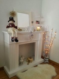 i'm going to make a faux fireplace like this Diy Christmas Fireplace, Fake Fireplace, Fireplace Design, Christmas Diy, Fireplace Ideas, Fireplace Mantels, Silver Christmas Decorations, Holiday Decor, Cardboard Fireplace