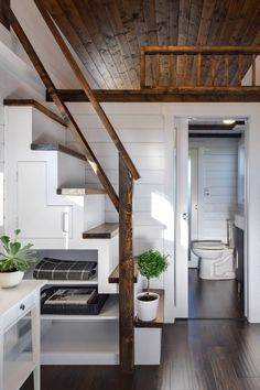 This modern tiny house measures 34' long and is custom built by Mint Tiny House Company. When you enter the house, you will end up in the...
