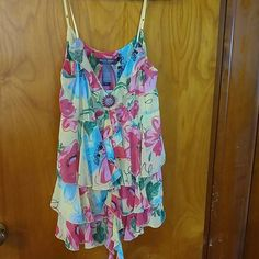 Adjustable strap summer top. Fun bright red flowers on a yellow backround. Adjustable straps. Brand new. Never worn. Tops Tank Tops