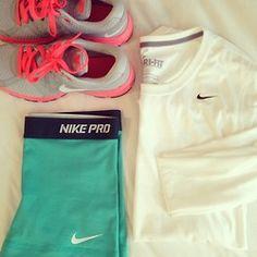 Teal nike pros, coral and grey tennies, white nike shirt